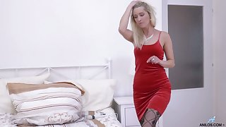 Stunning blonde in red dress and stockings Uma Zex stimulates cunt with a vibrator