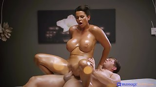 A lucky masseur gets fire star solejob from a oiled up busty MILF & fucks her