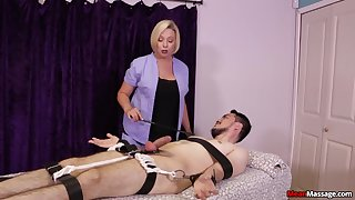 Strict mart masseuse gives a Femdom handjob give a bound client